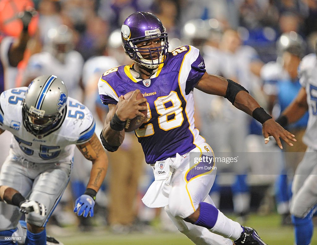 Adrian Peterson of the Minnesota Vikings runs with the ball during an NFL game against the Detroit Lions at the Mall of America Field at Hubert H...