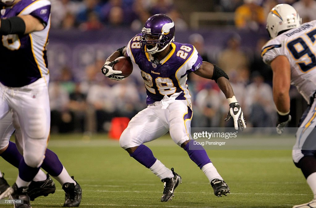Adrian Peterson of the Minnesota Vikings rushes against the San Diego Chargers at the Hubert H Humphrey Metrodome on November 4 2007 in Minneapolis...