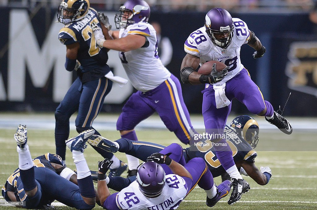 Adrian Peterson #28 of the Minnesota Vikings rushes in the fourth quarter against the St. Louis Rams at the Edward Jones Dome on September 7, 2014 in St. Louis, Missouri. The Vikings defeated the Rams 34-6.