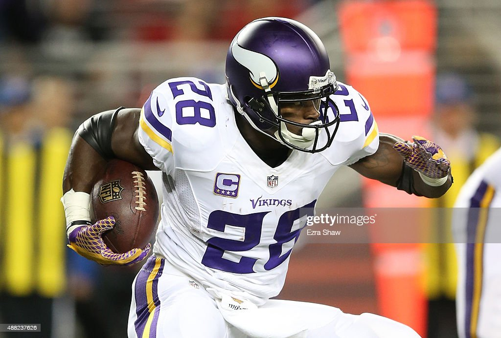Adrian Peterson of the Minnesota Vikings rushes with the ball against the San Francisco 49ers during their NFL game at Levi's Stadium on September 14...