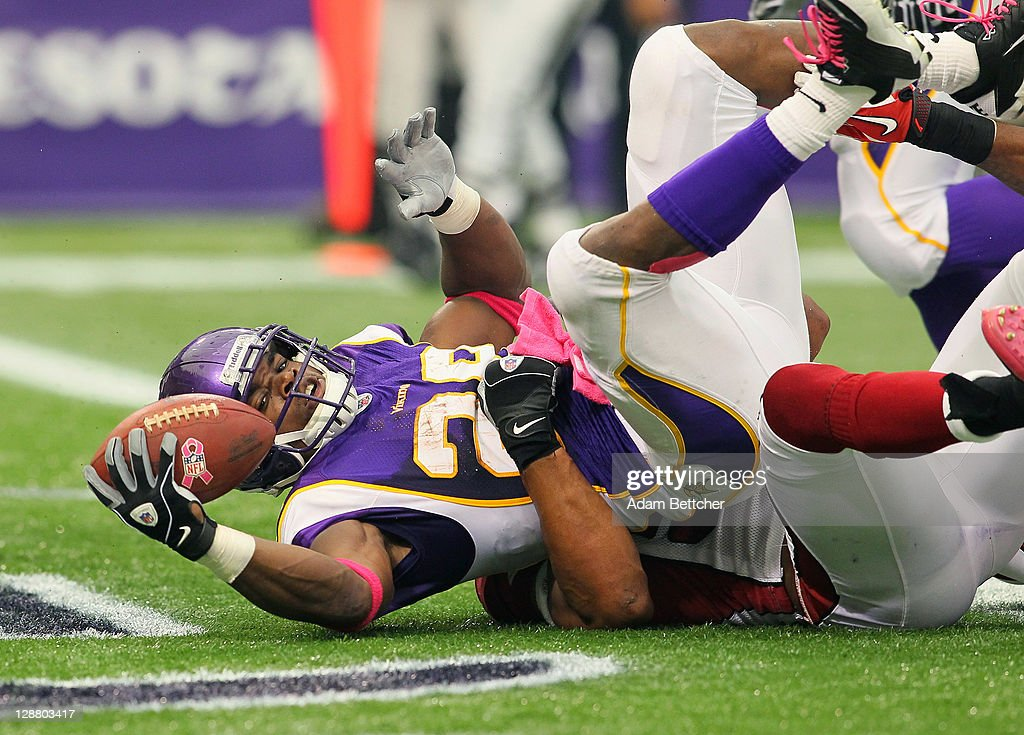 Adrian Peterson #28 of the Minnesota Vikings scores a touchdown against the Arizona Cardinals at the Hubert H. Humphrey Metrodome on October 9, 2011 in Minneapolis, Minnesota.