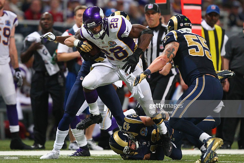 <a gi-track='captionPersonalityLinkClicked' href=/galleries/search?phrase=Adrian+Peterson+-+American+Football+Player+-+Minnesota+Vikings&family=editorial&specificpeople=210807 ng-click='$event.stopPropagation()'>Adrian Peterson</a> #28 of the Minnesota Vikings slips a tackle attempt by <a gi-track='captionPersonalityLinkClicked' href=/galleries/search?phrase=Craig+Dahl&family=editorial&specificpeople=4421268 ng-click='$event.stopPropagation()'>Craig Dahl</a> #43 the St. Louis Rams at the Edward Jones Dome on December 16, 2012 in St. Louis, Missouri.