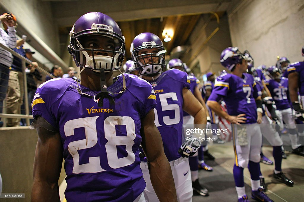Adrian Peterson #28 of the Minnesota Vikings waits before taking the field against the Washington Redskins on November 7, 2013 at Mall of America Field at the Hubert Humphrey Metrodome in Minneapolis, Minnesota.