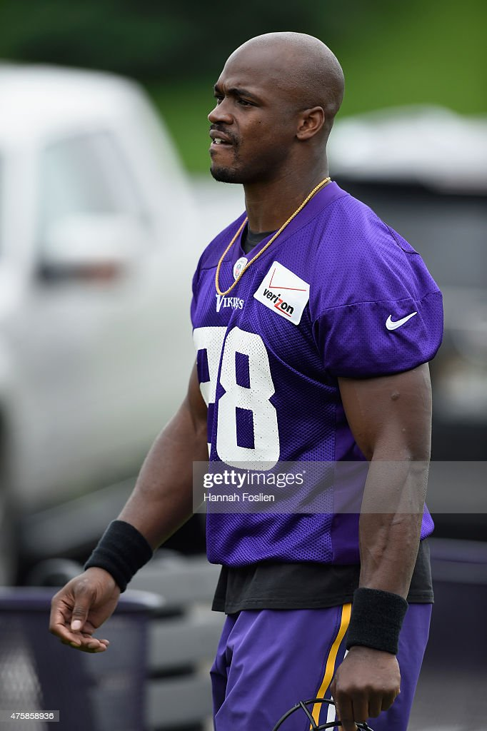 Adrian Peterson #28 of the Minnesota Vikings walks off the field after practice on June 4, 2015 at Winter Park in Eden Prairie, Minnesota.