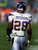 Adrian Peterson of the Minnesota Vikings warms up prior to the football game against the Denver Broncos at Invesco Field at Mile High on December 30...