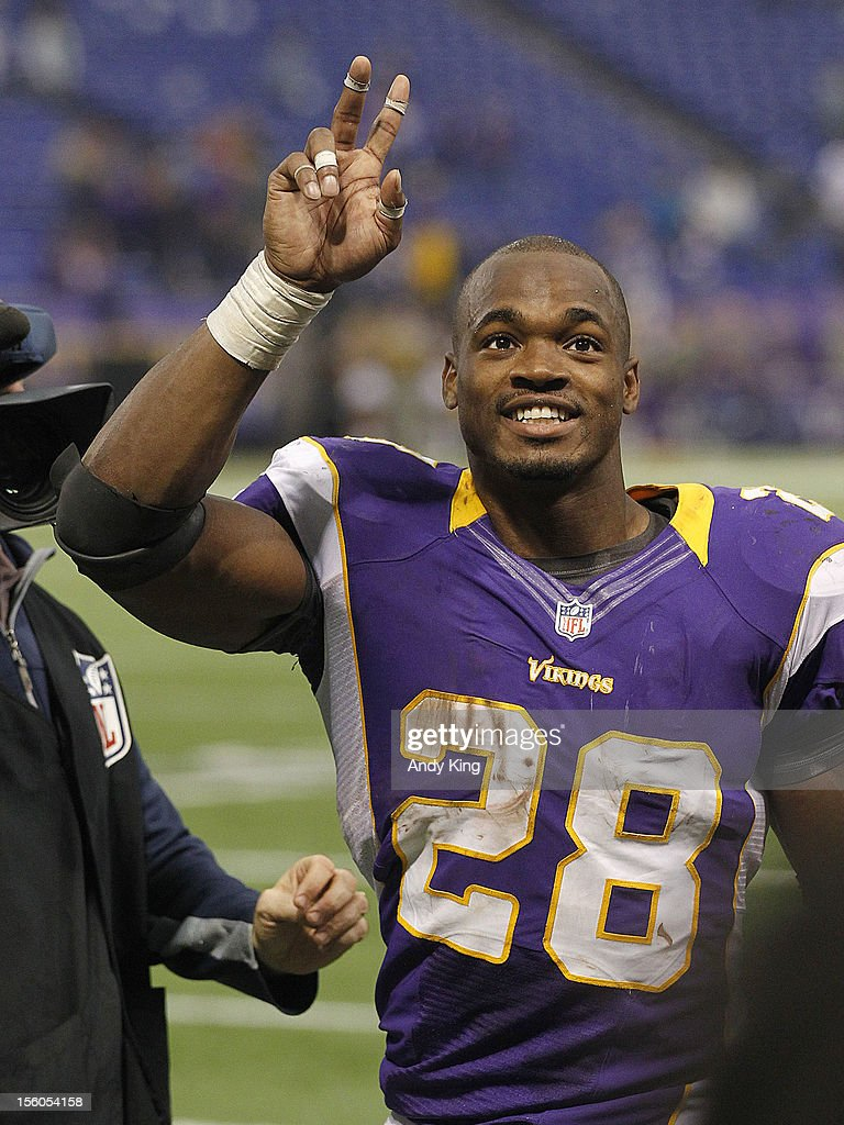 <a gi-track='captionPersonalityLinkClicked' href=/galleries/search?phrase=Adrian+Peterson+-+American+Football+Player+-+Minnesota+Vikings&family=editorial&specificpeople=210807 ng-click='$event.stopPropagation()'>Adrian Peterson</a> #28 of the Minnesota Vikings waves to the crowd after a game with the Detroit Lions on November 11, 2012 at Mall of America Field at the Hubert H. Humphrey Metrodome in Minneapolis, Minnesota. The Vikings defeated the Lions 34-24.