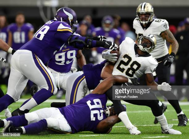 Adrian Peterson of the New Orleans Saints is tackled with the ball in the first quarter of the game against the Minnesota Vikings on September 11...