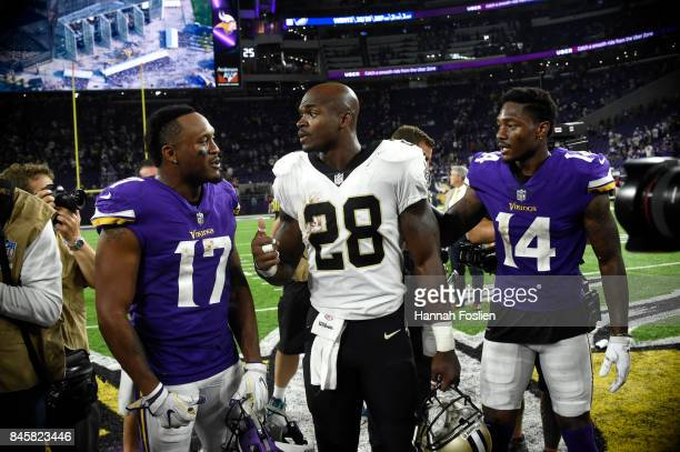 Adrian Peterson of the New Orleans Saints Jarius Wright of the Minnesota Vikings and Stefon Diggs meet mid field after the game on September 11 2017...