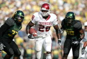Adrian Peterson of the Oklahoma Sooners scores a touchdown against the Oregon Ducks on September 16 2006 at Autzen Stadium in Eugene Oregon