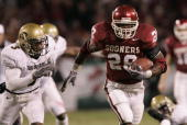 Adrian Peterson of the University of Oklahoma Sooners carries the ball against the University of Colorado Buffaloes in the Big 12 Championship game...