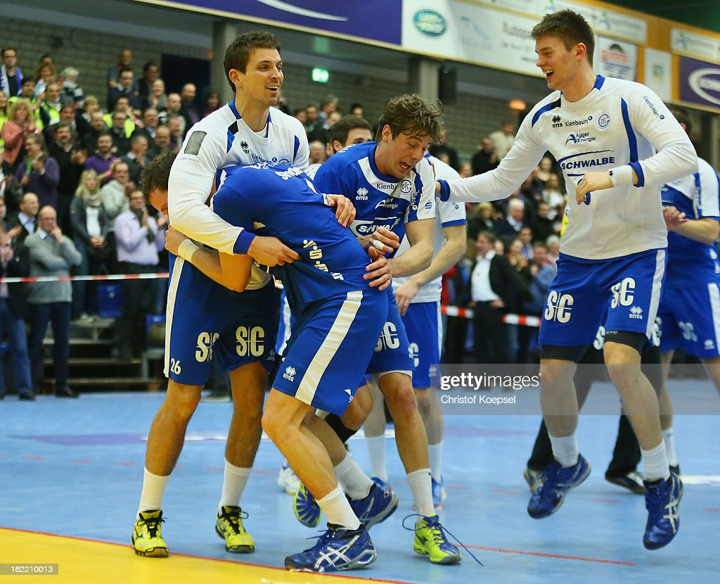 Adrian Pfahl, Christoph Schindler, Kentin Mahe and Barna Putics of Gummersbach celebrate after winning 27-26 the DKB Handball Bundesliga match between VfL Gummersbach and FrischAuf Goeppingen at Eugen-Haas-Sporthalle on February 20, 2013 in Gummersbach, Germany.