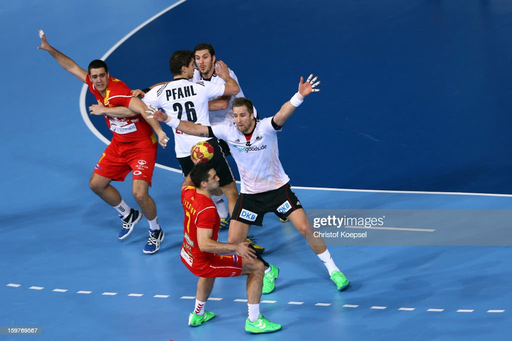 Adrian Pfahl (2nd L), Michael Haass (3rd L) and Oliver Roggisch of Germany (R) defend against Nikola Markoski (L) and Kiril Lazarov of Macedonia (2nd R) during the round of sixteen match between Germany and Macedonia at Palau Sant Jordi on January 20, 2013 in Barcelona, Spain.