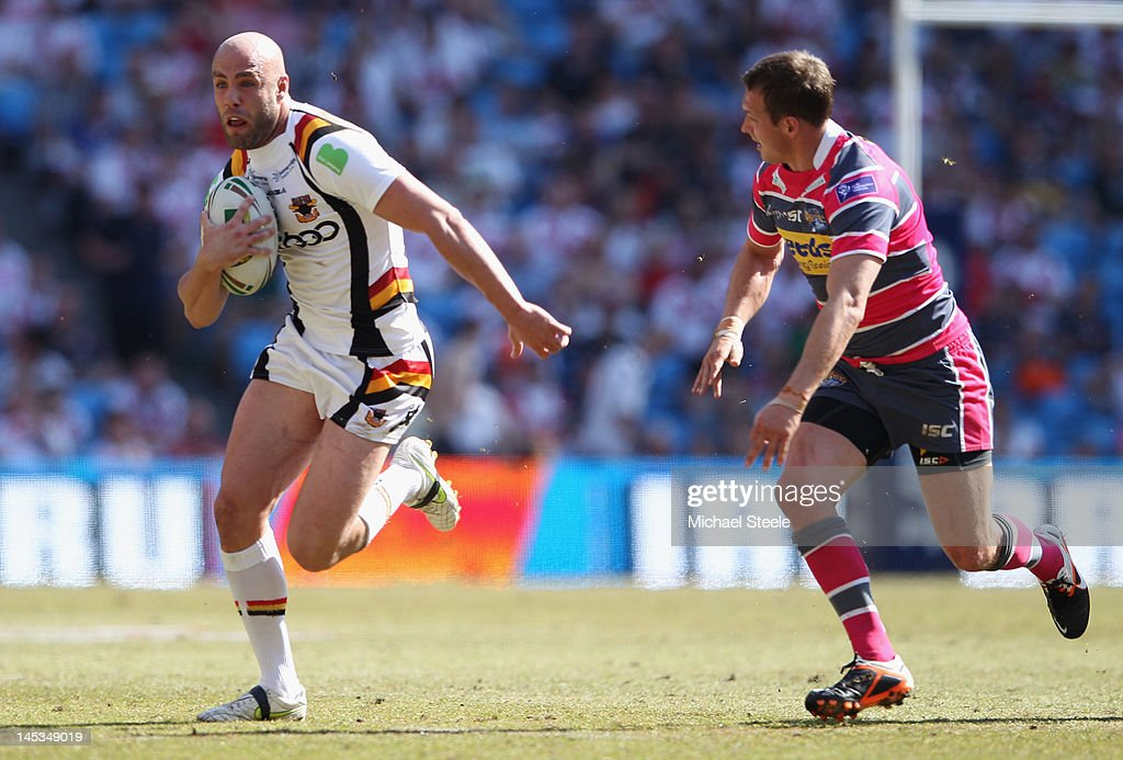 Adrian Purtell (L) of Bradford Bulls looks for a gap as Danny McGuire (R) of Leeds Rhinos closes in during the Stobart Super League 'Magic Weekend' match between Bradford Bulls and Leeds Rhinos at the Etihad Stadium on May 27, 2012 in Manchester, England.