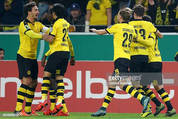 Adrian Ramos celebrates the first goal with Mats Hummels and Shinji Kagawa during the DFB Cup match between Borussia Dortmund and SC Paderborn at...