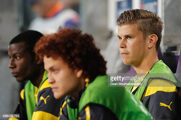 Adrian Ramos Mustafa Amini and Mitchell Langerak of Borussia Dortmund look on from the bench during the UEFA Champions League Group D match between...