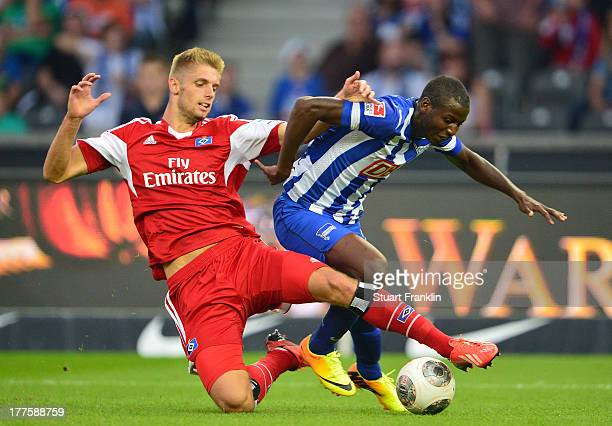 Adrian Ramos of Berlin is challenged by Lasse Sobeich of Hamburg during the Bundesliga match between Hertha BSC and Hamburger SV at Olympiastadion on...