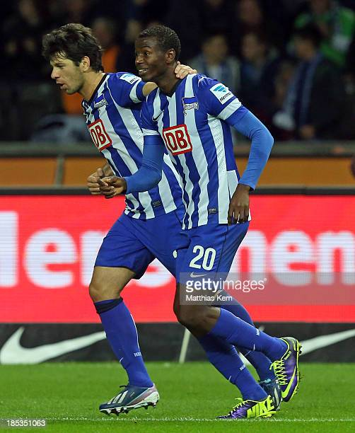 Adrian Ramos of Berlin jubilates with team mate Levan Kobiashvili after scoring the first goal during the Bundesliga match between Hertha BSC and...