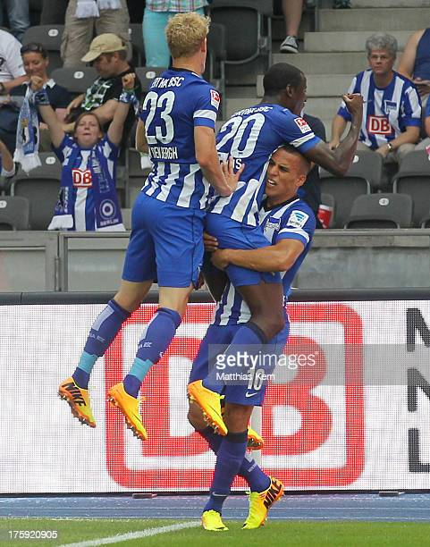 Adrian Ramos of Berlin jubilates with team mates after scoring the first goal during the Bundesliga match between Hertha BSC Berlin and Eintracht...