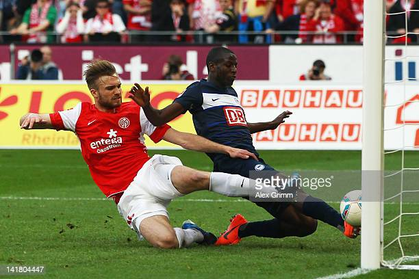 Adrian Ramos of Berlin scores his team's third goal against Jan Kirchhoff of Mainz during the Bundesliga match between FSV Mainz 05 and Hertha BSC...