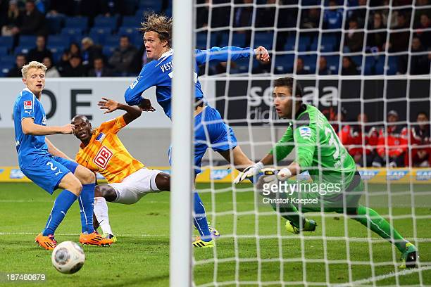 Adrian Ramos of Berlin scores the third goal against Andreas Beck Jannik Vestergaard and Koen Casteels of Hoffenheim during the Bundesliga match...