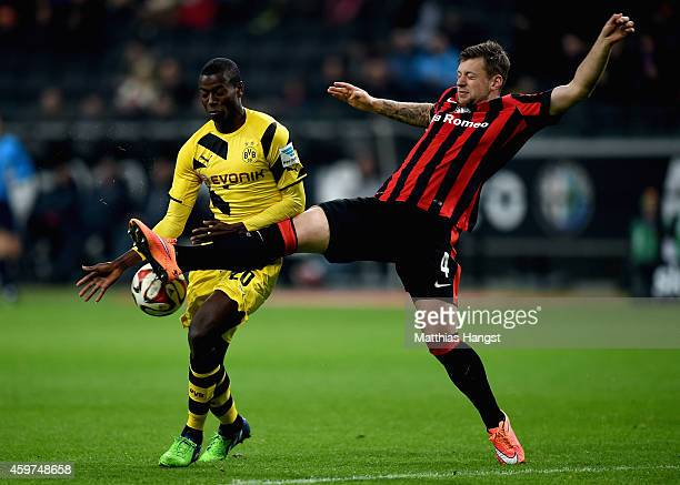 Adrian Ramos of Borussia Dormtund is challenged by Marco Russ of Eintracht Frankfurt during the Bundesliga match between Eintracht Frankfurt and...