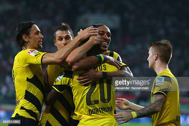 Adrian Ramos of Borussia Dortmund celebrates scoring their third goal with team mates during the Bundesliga match between FC Augsburg and Borussia...