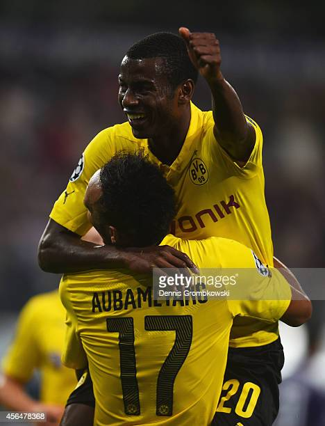 Adrian Ramos of Borussia Dortmund celebrates with team mate PierreEmerick Aubameyang as he scores their third goal during the UEFA Champions League...
