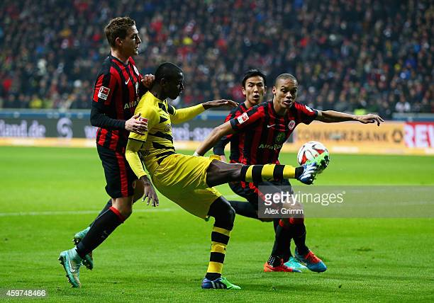 Adrian Ramos of Borussia Dortmund is challenged by Bastian Oczipka of Eintracht Frankfurt during the Bundesliga match between Eintracht Frankfurt and...
