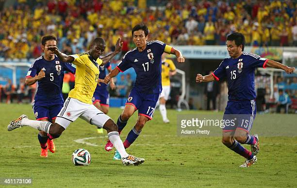 Adrian Ramos of Colombia takes on Yuto Nagatomo Makoto Hasebe and Yasuyuki Konno of Japan during the 2014 FIFA World Cup Brazil Group C match between...