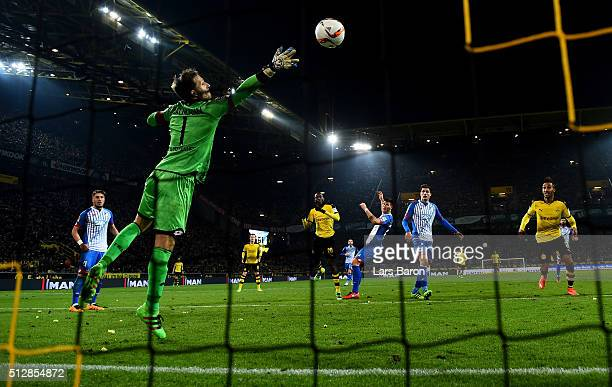 Adrian Ramos of Dortmund heads his teams second goal against goalkeeper Oliver Baumann of Hoffenheim during the Bundesliga macth between Borussia...