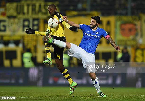 Adrian Ramos of Dortmund is challenged by Aytac Sulu of Darmstadt during the Bundesliga match between SV Darmstadt 98 and Borussia Dortmund at...