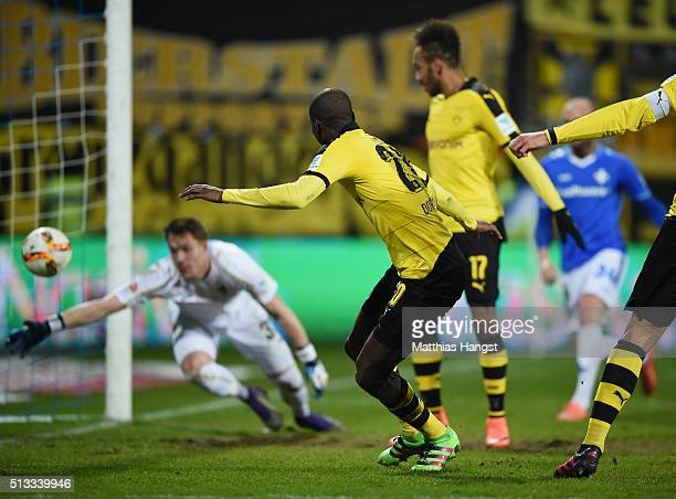 Adrian Ramos of Dortmund scores his team's first goal past goalkeeper Christian Mathenia of Darmstadt during the Bundesliga match between SV...