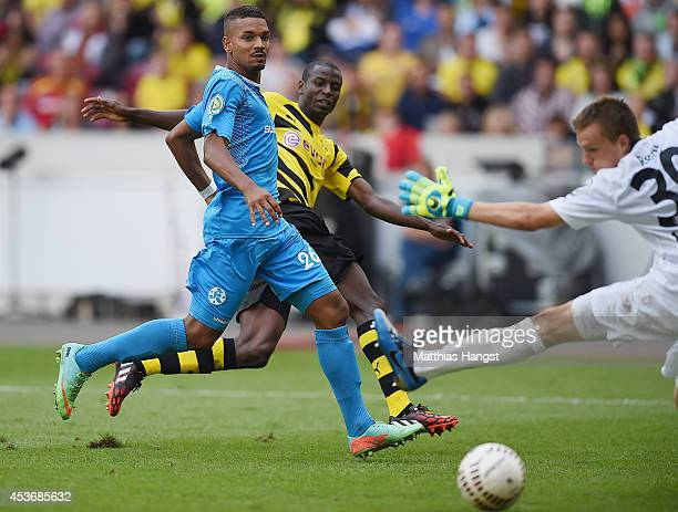 Adrian Ramos of Dortmund scores his team's fourth goal past Royal Fennell of Stuttgarter Kickers and goalkeeper MarkPatrick Redl of Stuttgarter...