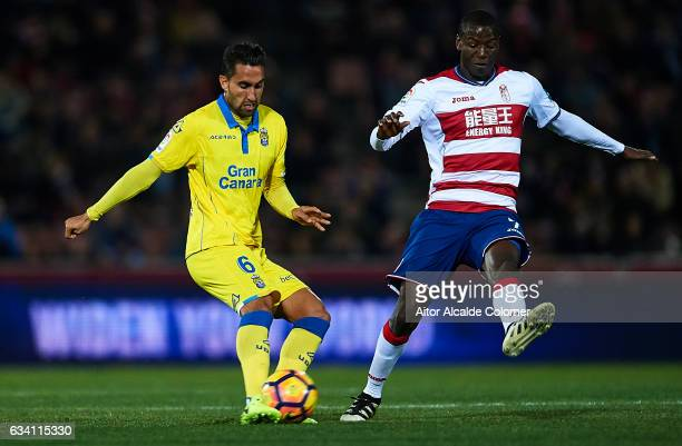 Adrian Ramos of Granada CF competes for the ball with Angel Montoro of Union Deportiva Las Palmas during the La Liga match between Granada CF v UD...