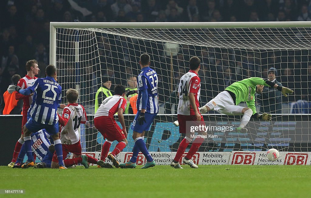 <a gi-track='captionPersonalityLinkClicked' href=/galleries/search?phrase=Adrian+Ramos&family=editorial&specificpeople=5547196 ng-click='$event.stopPropagation()'>Adrian Ramos</a> (L) of Hertha scores the third goal during the Second Bundesliga match between Hertha BSC Berlin and 1.FC Union Berlin at Olympic Stadium on February 11, 2013 in Berlin, Germany.