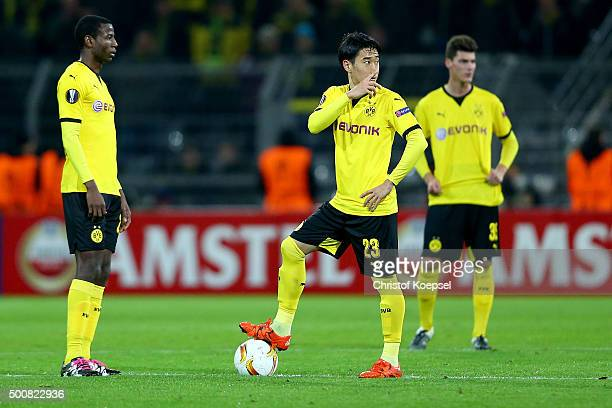Adrian Ramos Shinji Kagawa and Pascal Stenzel of Dortmund look dejected after the first goal of PAOK FC during the UEFA Europa League group C match...