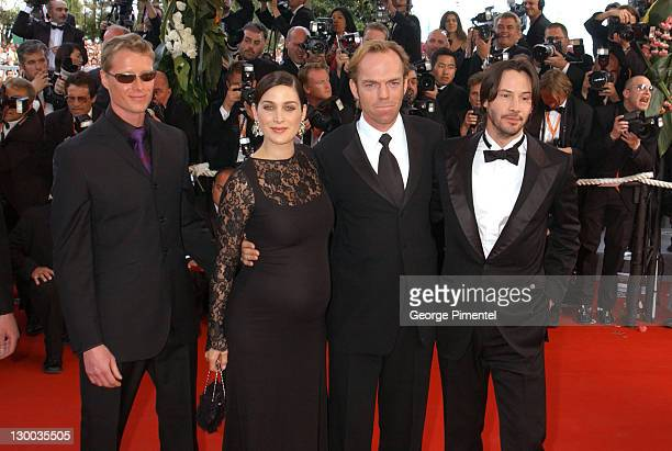 Adrian Rayment CarrieAnne Moss Hugo Weaving and Keanu Reeves