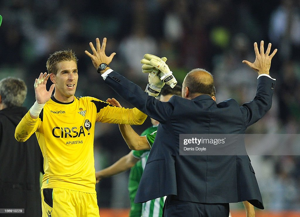 Adrian San Miguel of Real Betis Balompie celebrates with his head coach Pepe Mel after Betis beat Real 1-0 during the La Liga match between Real Betis Balompie and Real Madrid CF at Estadio Benito Villamarin on November 24, 2012 in Seville, Spain.
