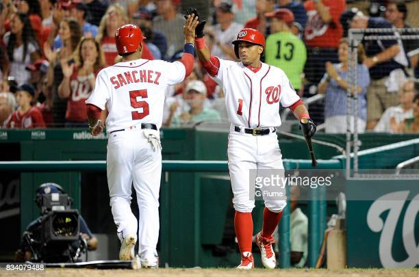 Adrian Sanchez of the Washington Nationals celebrates with Wilmer Difo after scoring against the Miami Marlins at Nationals Park on August 10 2017 in...