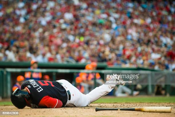 Adrian Sanchez of the Washington Nationals reacts after he was hit by pitch while attempting to bunt in the eighth inning against the New York Mets...