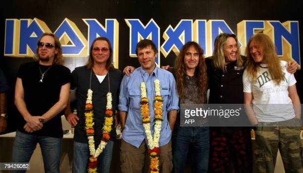 Adrian Smith Dave Murray Bruce Dickinson Steve Harris Nicko Mcbrain and Janick Gers of British band Iron Maiden pose for photographers during a press...