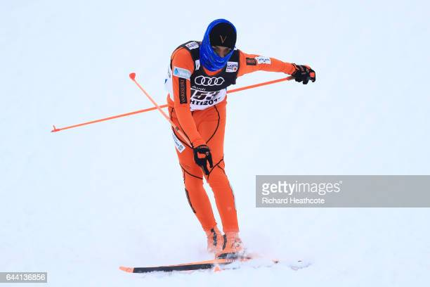 Adrian Solano of Venezuela crashes in the Men's 16KM Cross Country Sprint qualification round during the FIS Nordic World Ski Championships on...