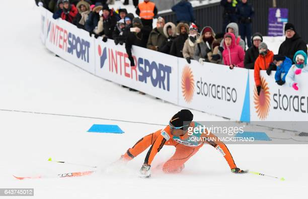 Adrian Solano of Venezuela falls as he competes in the Men 10 km Individual Classic Qualification Race of the 2017 FIS Nordic World Ski Championships...