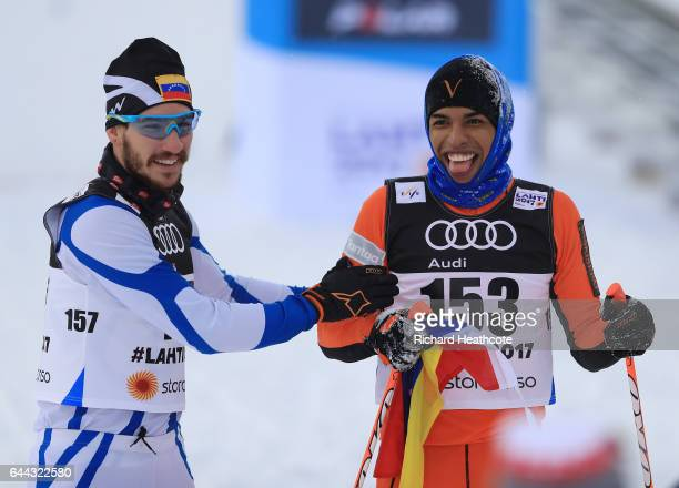 Adrian Solano of Venezuela is congratulated by Bernardo Baena of Venezuela after crossing the finish line in the Men's 16KM Cross Country Sprint...
