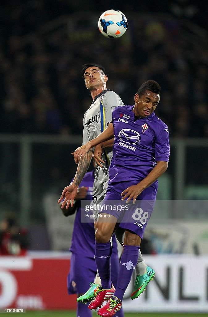 Adrian Stoian of AC Chievo Verona competes for the ball with Anderson (R) of ACF Fiorentina during the Serie A match between ACF Fiorentina and AC Chievo Verona at Stadio Artemio Franchi on March 16, 2014 in Florence, Italy.