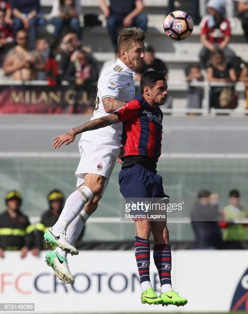 Adrian Stoian of Crotone competes for the ball in air with Juraj Kucka of Milan during the Serie A match between FC Crotone and AC Milan at Stadio...