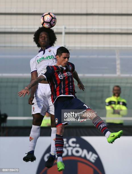 Adrian Stoian of Crotone competes for the ball with Carlos Sanchez of Fiorentina during the Serie A match between FC Crotone and ACF Fiorentina at...