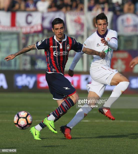 Adrian Stoian of Crotone competes for the ball with Cristian Tello of Fiorentina during the Serie A match between FC Crotone and ACF Fiorentina at...