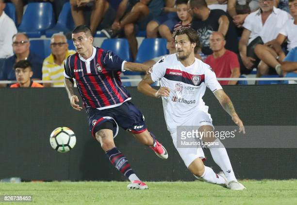Adrian Stoian of Crotone competes for the ball with Daniele Dessena of Cagliari during the PreSeason Friendly match between FC Crotone and Cagliari...