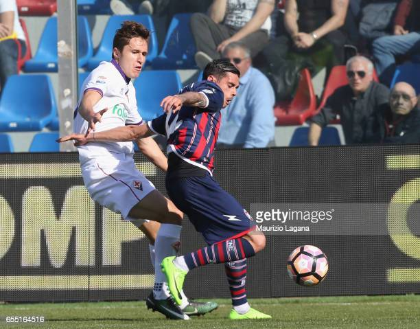 Adrian Stoian of Crotone competes for the ball with Federico Chiesa of Fiorentina during the Serie A match between FC Crotone and ACF Fiorentina at...